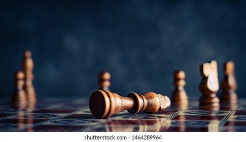 Chess pieces on a chess board with king and pawns.