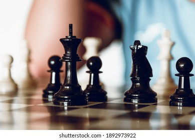 Chess pieces on chessboard. Playing chess at home