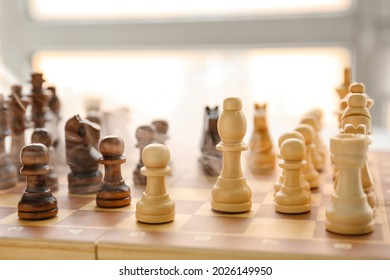 Chess pieces on game board, closeup