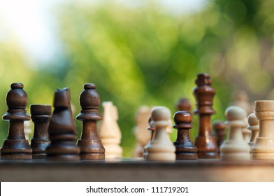 chess pieces on a table in the park