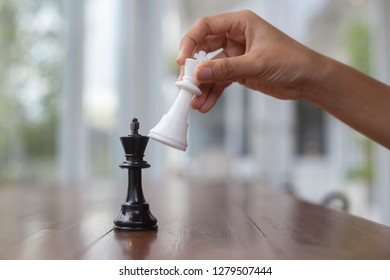 Chess placed on a wooden table,concept : of business strategy and tactic battle,symbol competition game success play victory war