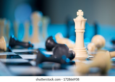 Chess queen among taken pieces