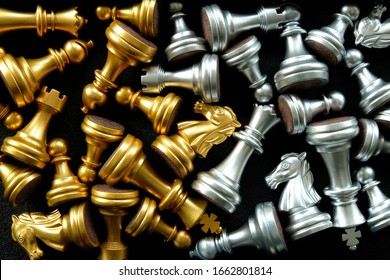Chess set with golden and silver chess pieces arranged separately. Concept for intense clash or team rivalry, battle stalemate, showdown, no clear winner, evenly matched, or teams with equal strength.