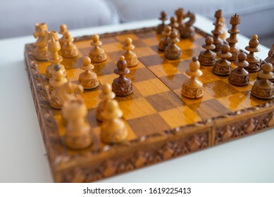 Chess set on the chess board. With selective focus on white pieces. Photography of chess pieces on a board. Chess Game, Strategy and Decision Making