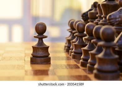 Chess standing on the board with a black pawn made a step forward
