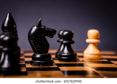 Chess. Strategy game. Competition success play. Intelligence challenge concept. King move on chessboard. White and black pawn on board. Business leadership. Leisure sport.