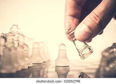 Chess. Strategy game. Competition success play. Intelligence challenge concept. King move on chessboard. White and black pawn on board. Business leadership. Leisure sport. - Shutterstock ID 525052798
