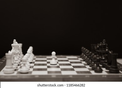Chess. Strategy game. White and black  chess pieces on board. Black background.