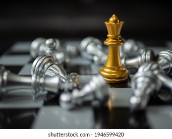 Chess. strategy ideas Planning and Decision concept business. gold queen chess surrounded by a number of fallen silver chess pieces , business strategy concept