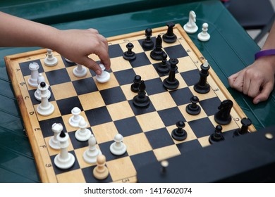 Chess tournament. Children play chess at the table