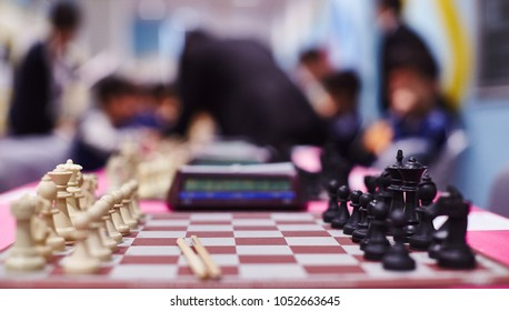 Chess tournament tables with chess timers and blank note papers