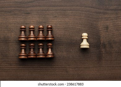 chess uniqueness concept on the wooden background