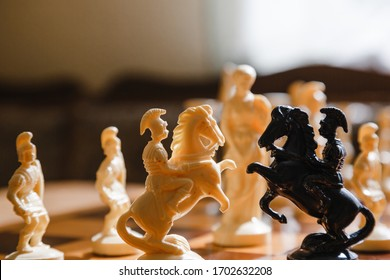 Chess white and black pieces fight on battlefield for their king