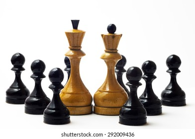 Chess white king and queen before the 8 black pawns on a white background