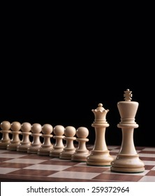 Chess - white King and Queen with eight pawns
