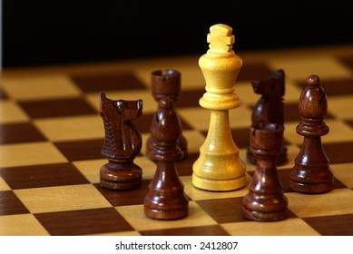 Chess: White king surrounded by black pieces