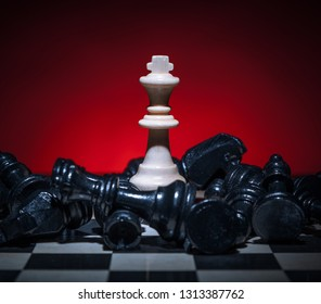 Chess white king won. Black pieces lost