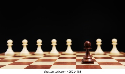 Chess - white pawns and outstanding black pawn on chessboard