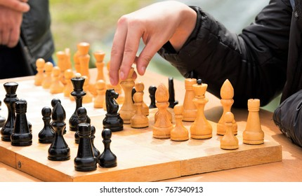 chess wooden figures game on the street