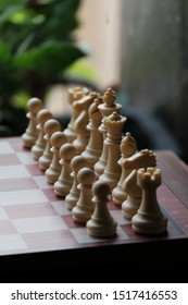 The chessboard with all chess pieces. The chess by plastic. Chess is a two-player strategy board game played on a checkered board with 64 squares arranged in an 8×8 grid