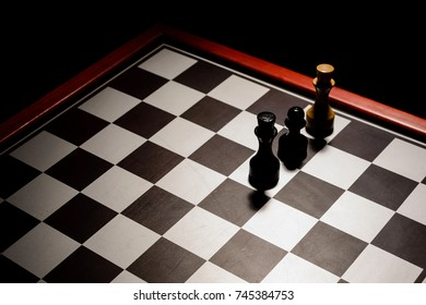 chessboard in the dark. stalemate the white king from a pawn. top view