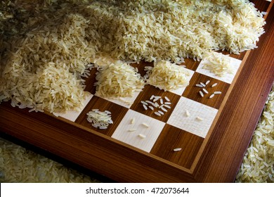 chessboard with exponential growing heaps of rice grains, legendary metaphor of unlimited growth