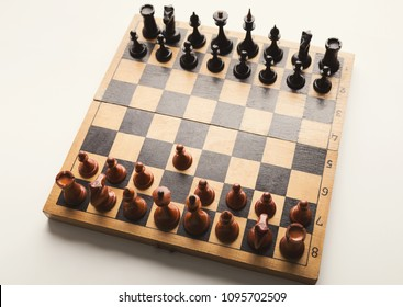 Chessboard with figures in progress. White pawn moves forward on chessboard, top view, copy space