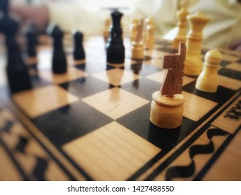 A chessboard is the type of game board used for the game of chess, . A chessboard is usually square in shape, with an alternating pattern of squares.