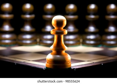 It is a lot of chessmen on a chess board. (are located it is horizontal). A black background.
