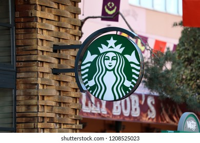 Chessy, France - October 13, 2018: Starbucks Sign Is Displayed At The Facade Of A Starbucks Store. Starbucks Corporation Is An American Coffee Company And The Largest Coffeehouse Company In The World