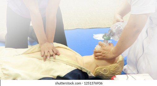 chest compression and ventilation with mask with bag on model for airway management in CPR training course at simulation room: soft focus