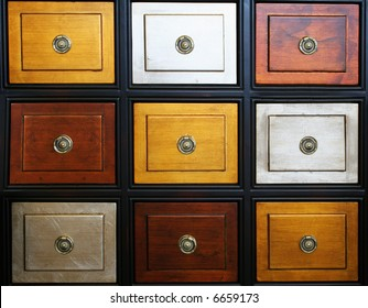 a chest of drawers that are different colors