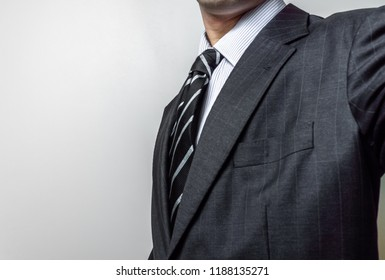 Chest of a man wearing suit and tie