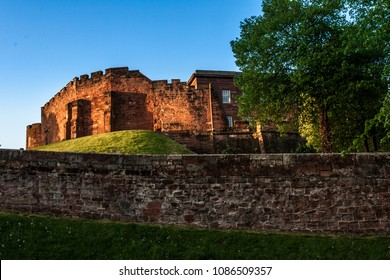 Chester Castle at sunset, beyond the city wall. The castle and the walls are one of the major tourist attraction of the City of Chester.