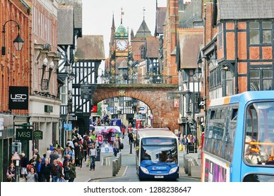 Chester, Cheshire, England, U.K. - 08/27/2014. View of the  Eastgate Clock (1899) from one side of Eastgate Street. The clock stands on an arch (1768) marking the original entrance to a Roman fort.