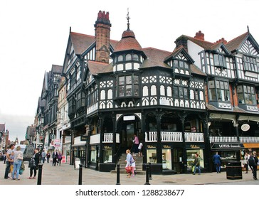 Chester, Cheshire, England, U.K. - 08/27/2014. View of the junction of Eastgate Row and Bridge Street. Chester is an ancient city popular with tourists and a good shopping centre.
