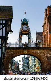 Chester, Cheshire / United Kingdom - September 21 2019: Iconic Chester's Eastgate Clock and Eastgate street full of people. This high resolution vertical panorama photo is made of 4 shots.