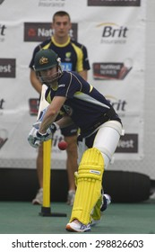 CHESTER LE STREET, ENGLAND. JULY 06 2012: Australia's captain Michael Clarke, batting whilst on a tensioned leash held by the Australian team masseuse during the official training and net session