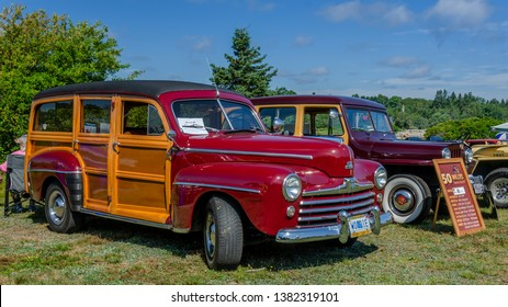 Chester, Nova Scotia, Canada - August 4, 2018 : 1948 Ford Woodie station wagon on display at Annual Graves Island Car Show, Graves Island Provincial Park, Chester, Nova Scotia.
