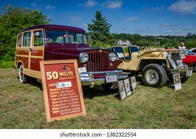 Chester, Nova Scotia, Canada - August 4, 2018 : 1950 Willys Woodie station wagon on display at Annual Graves Island Car Show, Graves Island Provincial Park, Chester, Nova Scotia.