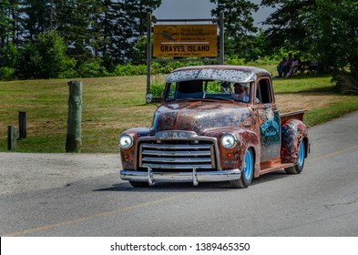 Chester, Nova Scotia, Canada - August 4, 2018 : 1952 GMC pickup truck rat rod leaving annual Graves Island Car Show, Graves Island Provincial Park, Chester Nova Scotia.