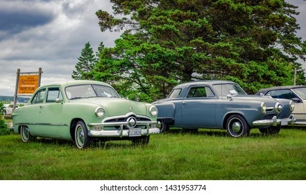 Chester, Nova Scotia, Canada - June 22, 2019 : 1950 Ford coupe & 1950 Studebaker Champion Starlight Coupe at annual Graves Island Car Show at Graves Island Provincial Park, Chester, Nova Scotia Canada