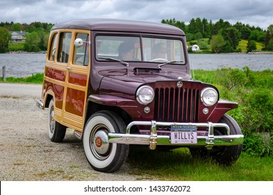 Chester, Nova Scotia, Canada - June 22, 2019 : 1950 Willys Jeep Woodie Station Wagon at annual Graves Island Car Show at Graves Island Provincial Park, Chester, Nova Scotia Canada.
