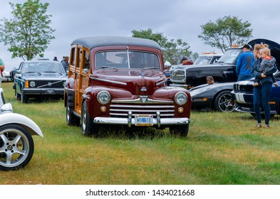 Chester, Nova Scotia, Canada - June 22, 2019 : 1948 Ford Woodie at annual Graves Island Car Show at Graves Island Provincial Park, Chester, Nova Scotia Canada.