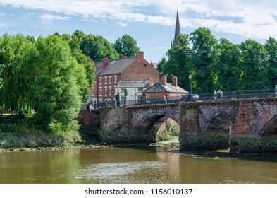 Chester, UK: Aug 6, 2018: The Old Dee Bridge is the oldest bridge in the historic city of Chester. The bridge carries pedestrians and traffic across the River Dee.