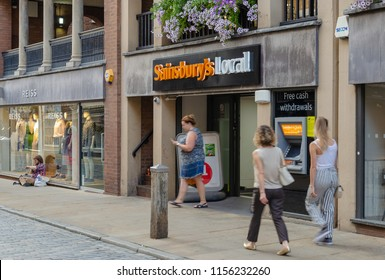 Chester, UK: Aug 6, 2018: People walk past the Sainsbury's Local store in the city centre of Chester.