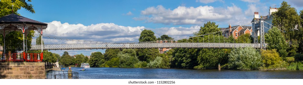 Chester, UK - August 2nd 2018: A beautiful panoramic view of the River Dee and the Dee Suspension Bridge in the historic city of Chester in Cheshire, UK.