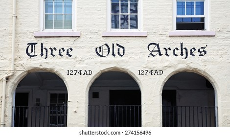 CHESTER, UK - JULY 22, 2014 - Three Old Arches dated 1274AD along Bridge Street, the stone frontage is the earliest shop front still surviving in England, Chester, Cheshire, England, UK, July 22, 2014
