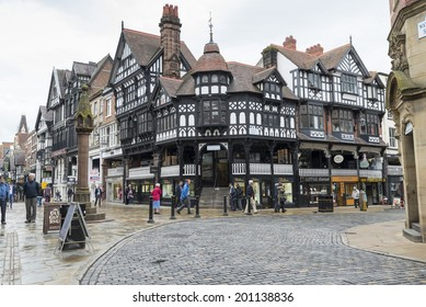 CHESTER, UK - JUNE 9,2014: City centre shopping in the historic centre of Chester. The Cross marks the centre of the Roman city.