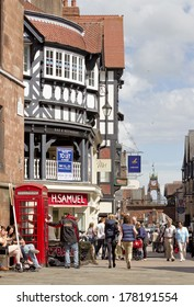CHESTER, UK - MAY 9: Shoppers on the street on May 9 2011 in Chester, UK. Much of the architecture of central Chester looks medieval and some of it is but by far the greatest part of it is Victorian.